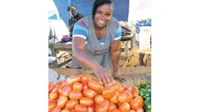 A-market-vendor-who-fills-her-bags-with-CSEC-subjects.jpg